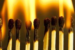 burning matches Arkivfoton