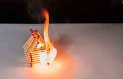 Burning matches house - games with fire ends with accident Stock Photos