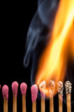 Burning matches in a line Royalty Free Stock Images