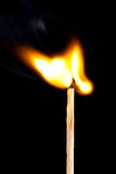 Burning matchstick Stock Image