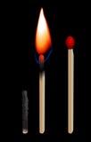 Burning matchstick. On black background Stock Image