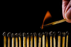 Burning matchstick Royalty Free Stock Image