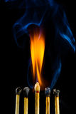 Burning matchstick Stock Photography