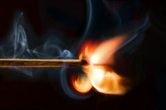 Burning matchstick, black background Stock Photography