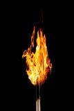 Burning matchstick on black. Bburning matchstick on black background Royalty Free Stock Photos