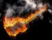 Burning melting guitar. Burning smoking melting guitar in black space Royalty Free Stock Image