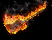 Burning melting guitar Stock Images
