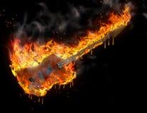Burning melting guitar. Burning smoking melting guitar in black space Stock Images