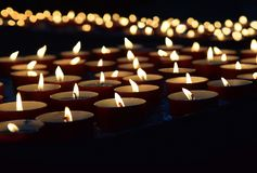 Burning memorial candles royalty free stock photography