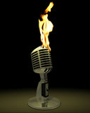 Burning microphone. Classic, vintage microphone with flames comming out stock photos