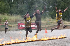 Burning Minions. Minions leap the Pyromaniac fire obstacle.  Rugged Maniac Competition, August 15, 2015, Vancouver, BC Stock Photography