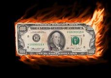 Burning money. Burning a old one hundred dollar bill isolated Stock Photos