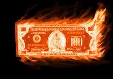 Burning money. Burning a old one hundred dollar bill isolated Stock Photography