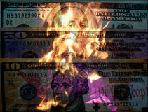Burning money. Scene with American dollars and fire Stock Image
