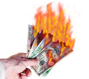 Burning money Stock Photo