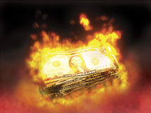 Burning money. Stack of dollar bills on fire Royalty Free Stock Images