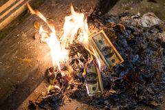 Burning money - 100 american dollar banknotes in  flames Royalty Free Stock Photography