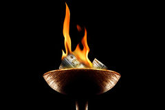 Burning money Stock Photography