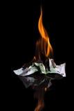Burning money. One hundred euro banknotes Royalty Free Stock Image