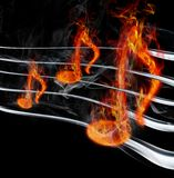 Burning music. Image of burning music on a black background Royalty Free Stock Photo