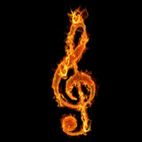 Burning music key. Firing music key at black background at flames Royalty Free Stock Photos