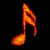 Burning musical sign. Fire on black background Stock Photography