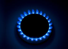 Burning natural gas. Natural gas burns with a blue flame in the dark closeup Stock Photos