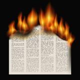 Burning newspaper Stock Photo