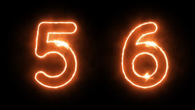Burning Numbers. Outline Fire Numbers on Black Background Royalty Free Stock Image