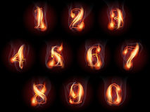 Burning numbers set. Set of fire burning arabic numbers Royalty Free Stock Photography