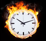Burning objects and objects in fire. Clock in fire on black background Royalty Free Stock Photos