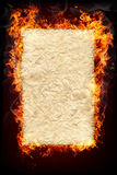 Burning objects and objects in fire. Sheet of paper for text or object to be inserted and surrounded by fire Royalty Free Stock Photography