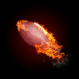 Burning objects and objects on fire background. American football ball in fire  on black background - flying up Stock Photos