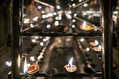 Oil candles inside buddhist temple Royalty Free Stock Photo