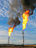 Burning oil gas flares stock image