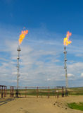Burning oil gas flares Royalty Free Stock Photography