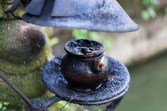 Burning oil lamp in Pura Saraswati Temple Royalty Free Stock Photo
