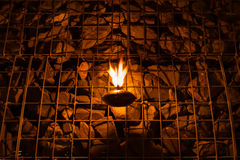 Burning oil lamp and rock wall. Burning oil lamp and rock wall in the dark night Stock Image