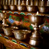 Burning oil lamps at Buddhist monastery Stock Images