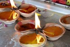 Burning oil lamps. India Stock Photo