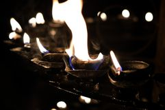 Burning Oil Lamps Stock Images