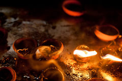 Burning oil lamps at religious temple Royalty Free Stock Image