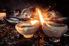 Burning oil lamps at temple Royalty Free Stock Images