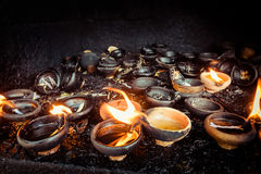 Burning oil lamps at temple Stock Photos