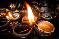 Burning oil lamps at temple Royalty Free Stock Photos