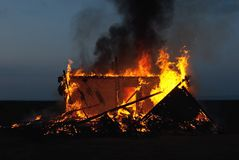 Burning old abandoned house Royalty Free Stock Photo