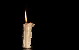 Burning Old Candle on Black Background. royalty free stock images