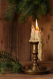 Burning old Candle Vintage Bronze candlestick on Stock Photos