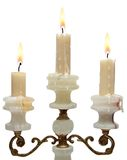 Burning old candle vintage golden candlestick. onyx Royalty Free Stock Photos