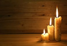 Burning old candle on wooden vintage background Royalty Free Stock Photo